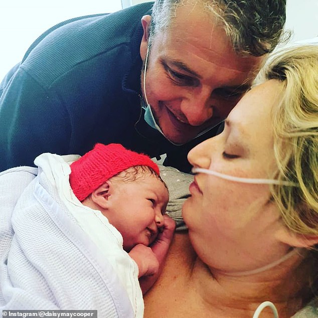 Adorable: Daisy shares her two-week-old son Michael with her husband Will Weston. The couple also has a daughter named Pep