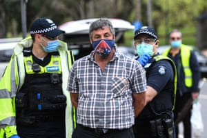 Another person detained in Melbourne during the protests.