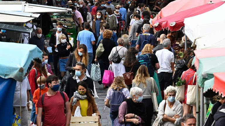 """People wearing masks to limit the spread of the new Coronavirus (Covid-19) shop at a market on September 12, 2020 in Rennes, western France.  It shows the development of the epidemiological situation of Corona virus in France """"Clear deterioration""""French Prime Minister announced on September 11th.  (Photo by Damien Meyer / AFP) (Photo by Damien Meyer / AFP via Getty Images)"""