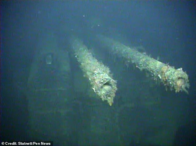 Footage of Karlsruhe, found 490 meters below sea level, shows the ship upright with its cannons pointing to the sea (pictured)