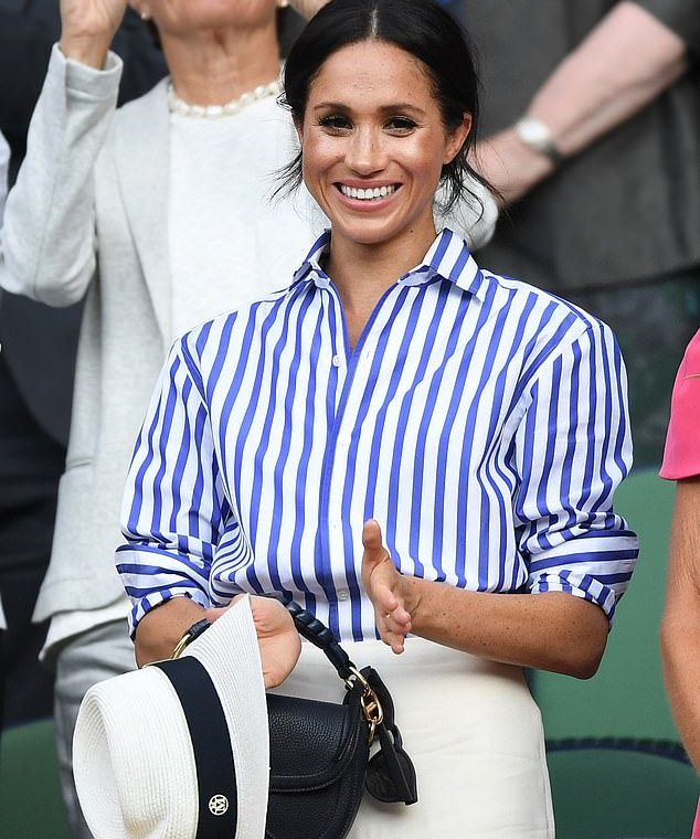 Photo of Duchess of Sussex, 39, wearing a blue and white striped shirt from Ralph Lauren to Wimbledon in 2018