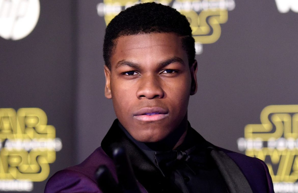 """John Boyega attends the premiere of Walt Disney Pictures and Lucasfilm's """"Star Wars: The Force Awakens"""" on December 14th, 2015 in Hollywood, California"""