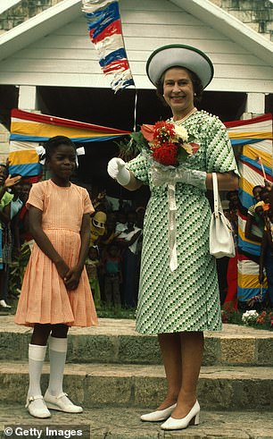 The Visits: A photo of Queen Elizabeth II smiling with a young girl in Barbados on November 1, 1977