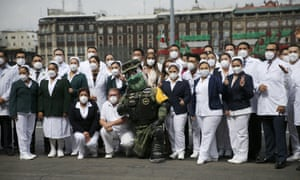 Medical personnel dealing with Covid-19 patients who have received a medal from the government in recognition of their efforts, pose for a photo with the military amulet during the annual Independence Day military parade in Mexico City's main square, Zocalo, Wednesday, September 16, 2020.