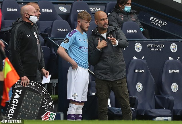 Tommy Doyle (left) played for Manchester City last season under Pep Guardiola (right).