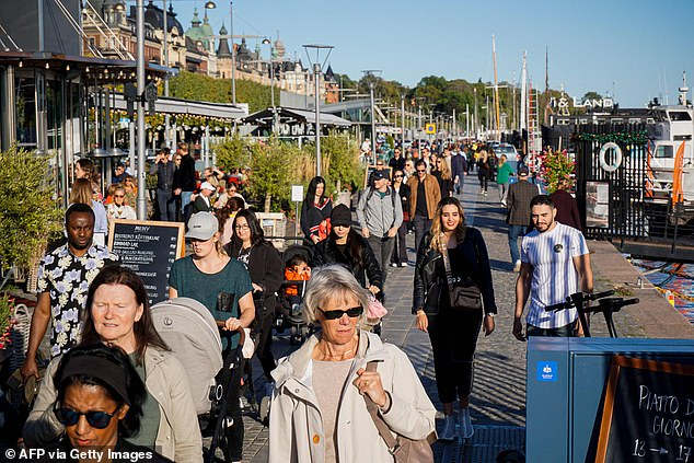 The Scandinavian country was the only country in Europe that did not implement strict lockdown measures at the start of the epidemic.  Pictured: Crowds walking through Stockholm this week
