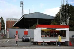 Women wait in a mobile sandwich bar outside the racetrack stadium on Thursday.