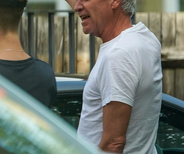 Philip Schofield inspects the damage to his neighbor's car