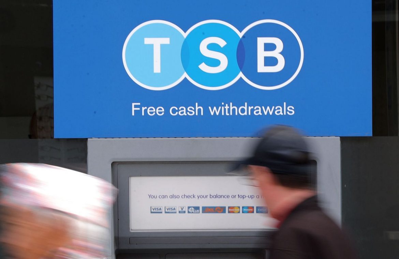 A man uses a TSB cash machine in Ashford, Kent