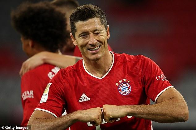 Bayern Munich's Robert Lewandowski celebrates scoring his team's third goal of the match