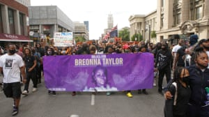 Protesters march in downtown Louisville after a grand jury decided last week not to press charges for the killing of police officers involved in the shooting of Briona Taylor.