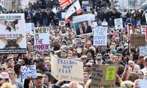 People take part in the 'We Don't Agree' march on Trafalgar Square in London, organized by the Stop New Normal Foundation, to protest the coronavirus restrictions