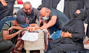 An Iraqi family mourns the coffin of a relative during a reburial ceremony at the vast Wadi al-Salam cemetery in the Shiite holy city of Najaf.