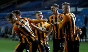 Alfie Jones of Hull City celebrated with his team-mates after scoring the winning penalty kick.
