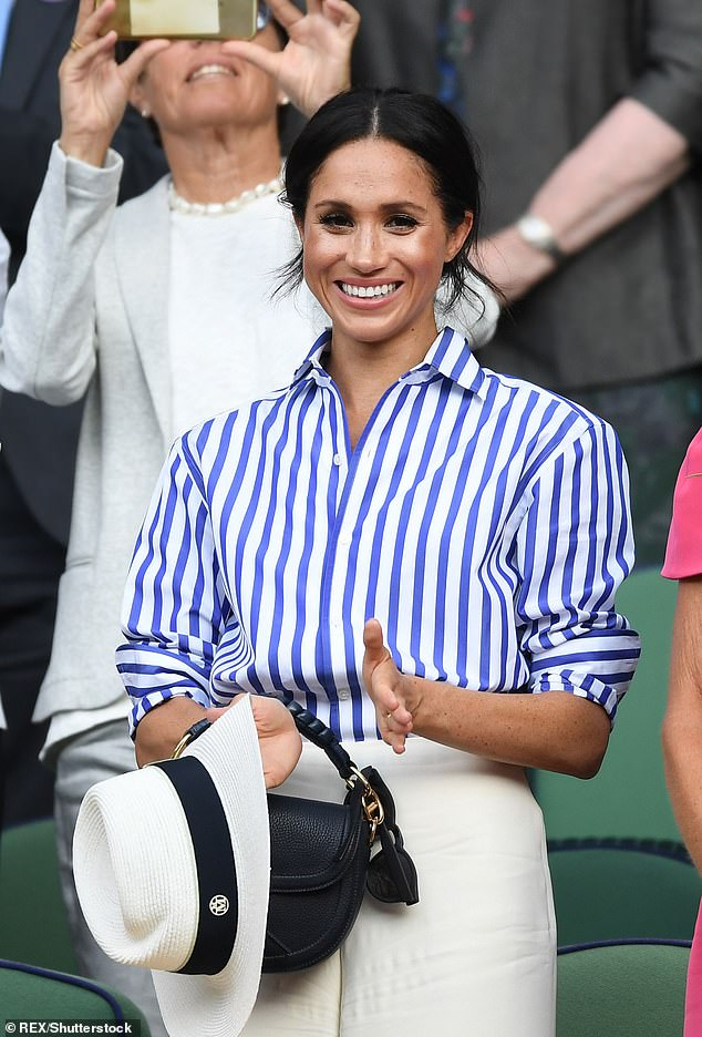The Duchess of Sussex, 39, is shown wearing a blue and white striped shirt from Ralph Lauren to Wimbledon in 2018