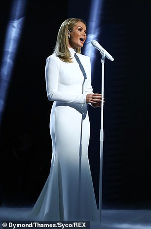 Witch: The singer's band has pointed shoulders and comfortably fits its frame to the waist, as the ivory skirt has fallen into a fishtail shape.