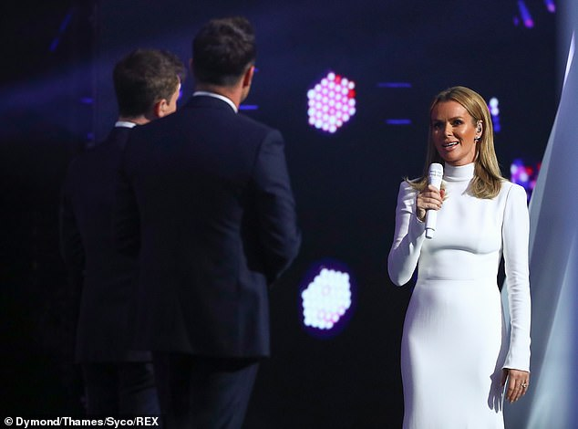 Maintain her distance: Amanda was seen standing two meters away from co-hosts You MacBartlin and Declan Donnelly.