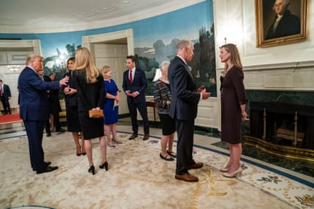President Donald Trump and First Lady Melania Trump with Senator Kelly Loeffler (R), left, and Senator Thom Tillis (RNC) with Judge Amy Connie Barrett, right, at a reception on Barrett's nomination day at the White House in Washington, September 26 2020. Senator Josh Hawley (R) in the center.  (Doug Mills / The New York Times) Credit: New York Times / Redux / eyevine For more information, please contact eyevine tel: +44 (0) 20 8709 8709 e-mail: info@eyevine.com www.eyevine.com