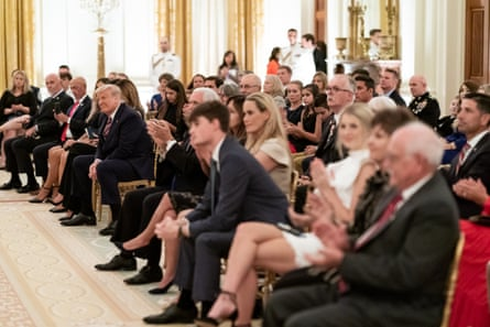 President Donald J. Trump listens as songs are sung in a candlelit revival during a reception honoring the Gold Star families on Sunday, September 27, 2020, in the East Room of the White House.