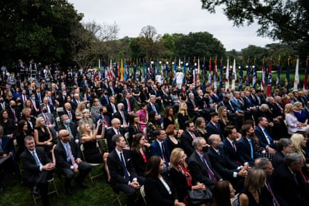 Staff and visitors listen as President Donald J. Trump speaks with Judge Amy Connie Barrett during a ceremony announcing Barrett's nomination for the Supreme Court in the White House Rose Garden on Saturday, September 26, 2020 in Washington, DC.