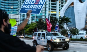 The nation is divided.  Supporters of Biden and Trump in Miami, Florida, yesterday.