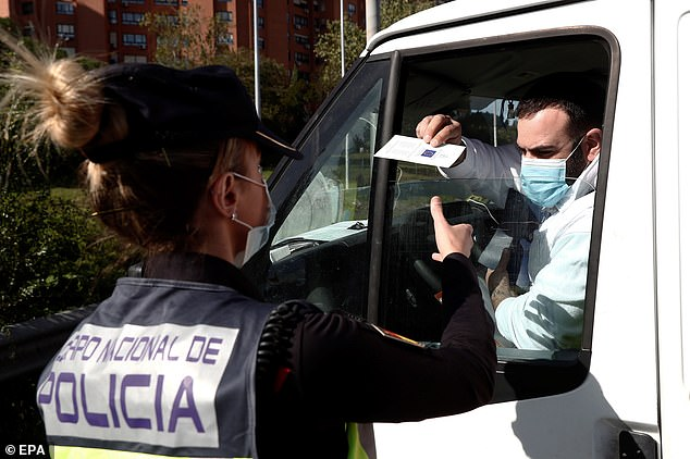 Police are controlling motorists at a checkpoint in Madrid on Monday after the Health Ministry imposed new measures on Friday