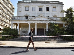 A woman passes by a cordoned off building in Varosha.