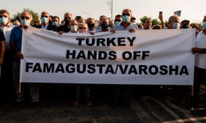 Greek Cypriots protest at the Derinia crossing after Turkish authorities reopen Varosha, a coastal neighborhood in the historic city of Famagusta.
