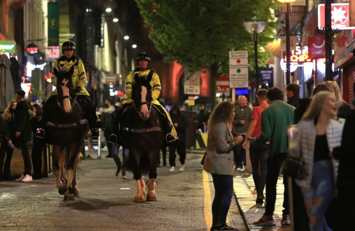 Police officers are seen on horseback as people enjoyed a night out in Liverpool before expected tougher restrictions