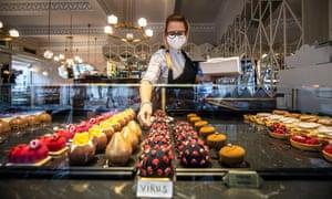 A waitress serves coronavirus candy in a Prague café.