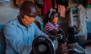 Tailors make face masks in Malawi.