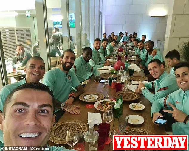 Ronaldo (bottom left) poses for a photo with his team-mates hours before the word spreads