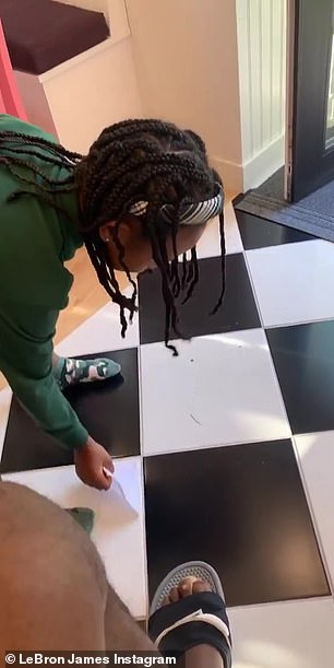Proud: New homeowner Zhuri hilariously swept the ground as she tracked LeBron into some dirt on her shiny custom floors