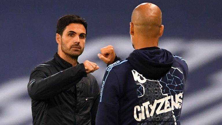 Manchester City coach Pep Guardiola and Arsenal manager Mikel Arteta after City's 3-0 victory