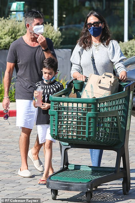 The whole gang: The music mogul, 61, looked happy and healthy when he showed up with Lauren Silverman, 43, and Eric, six, during a grocery store in Los Angeles on Sunday