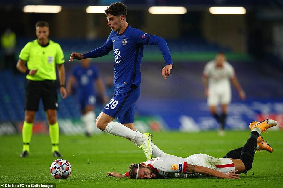 Kai Havertz tries to advance the ball while under pressure from Sevilla's Nemanja Godelli in the first half on the bridge.