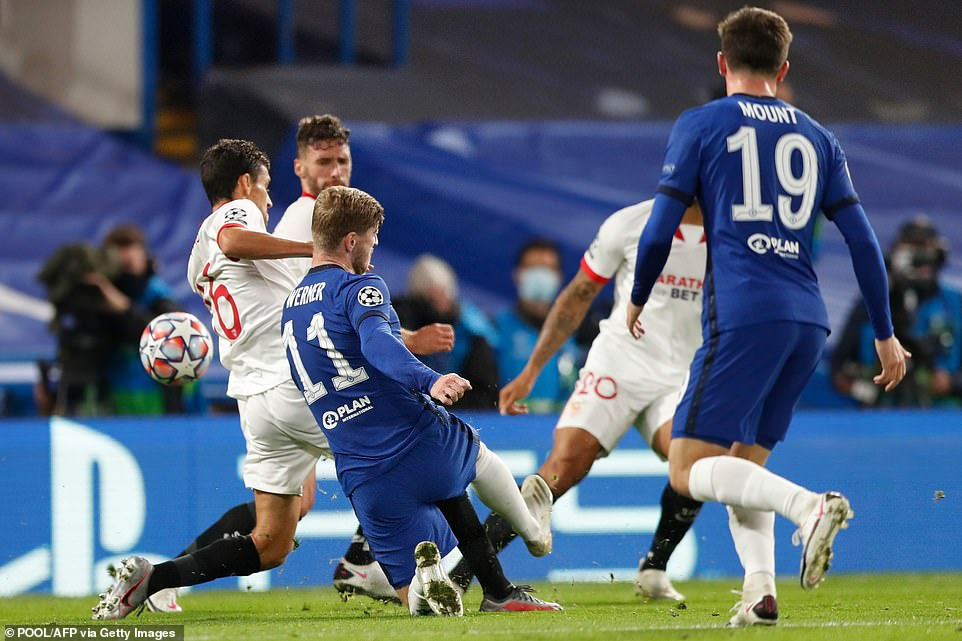 Werner attempts his shot on the edge of the penalty area under pressure from three Seville defenders in the first period.