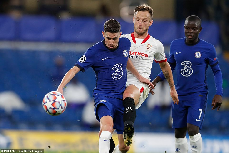 Blues midfielder Jorginho wrestles over the ball with Sevilla's Ivan Rakitic, who returned to the club in the summer from Barcelona.