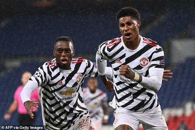 Marcus Rashford (right) was the difference as he scored late to win the United match