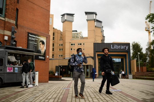 Young men walk by the Coventry University library as they leave the campus building at the start of the new academic year at Coventry University