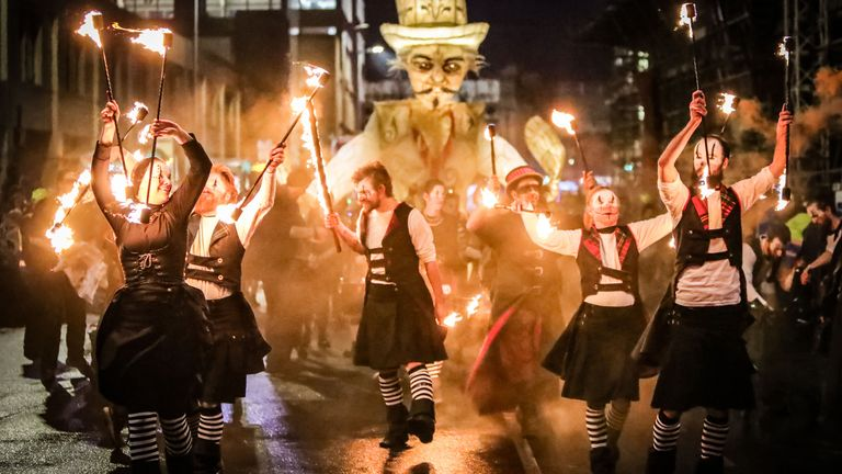 Artists take part in the annual Halloween Paisley Festival last year