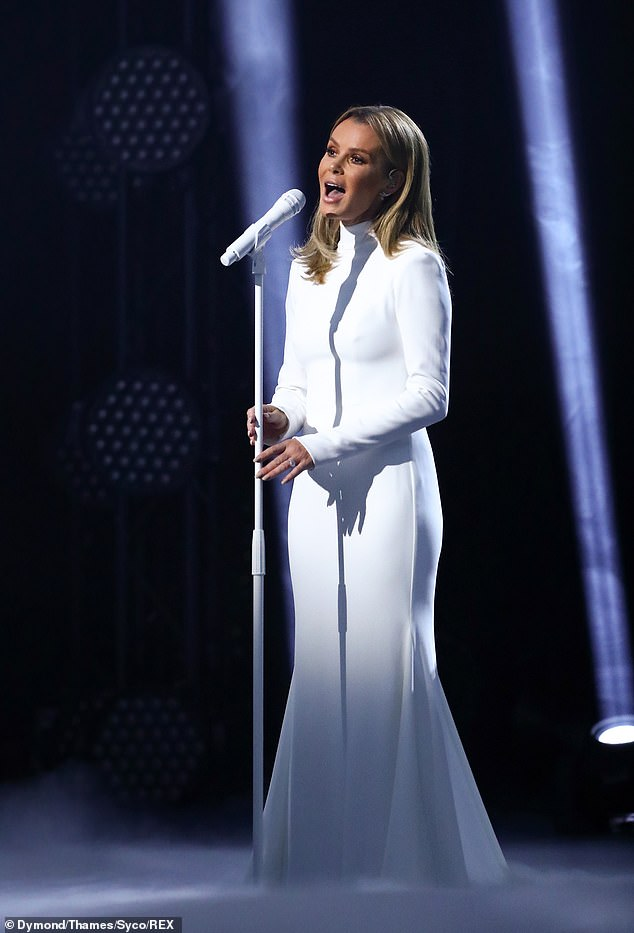 wow! Amanda Holden looked sober in a white turtleneck dress in scenes scheduled to air on Britain's Got Talent show on Saturday, after Ofcom received 235 complaints about her racy dress.