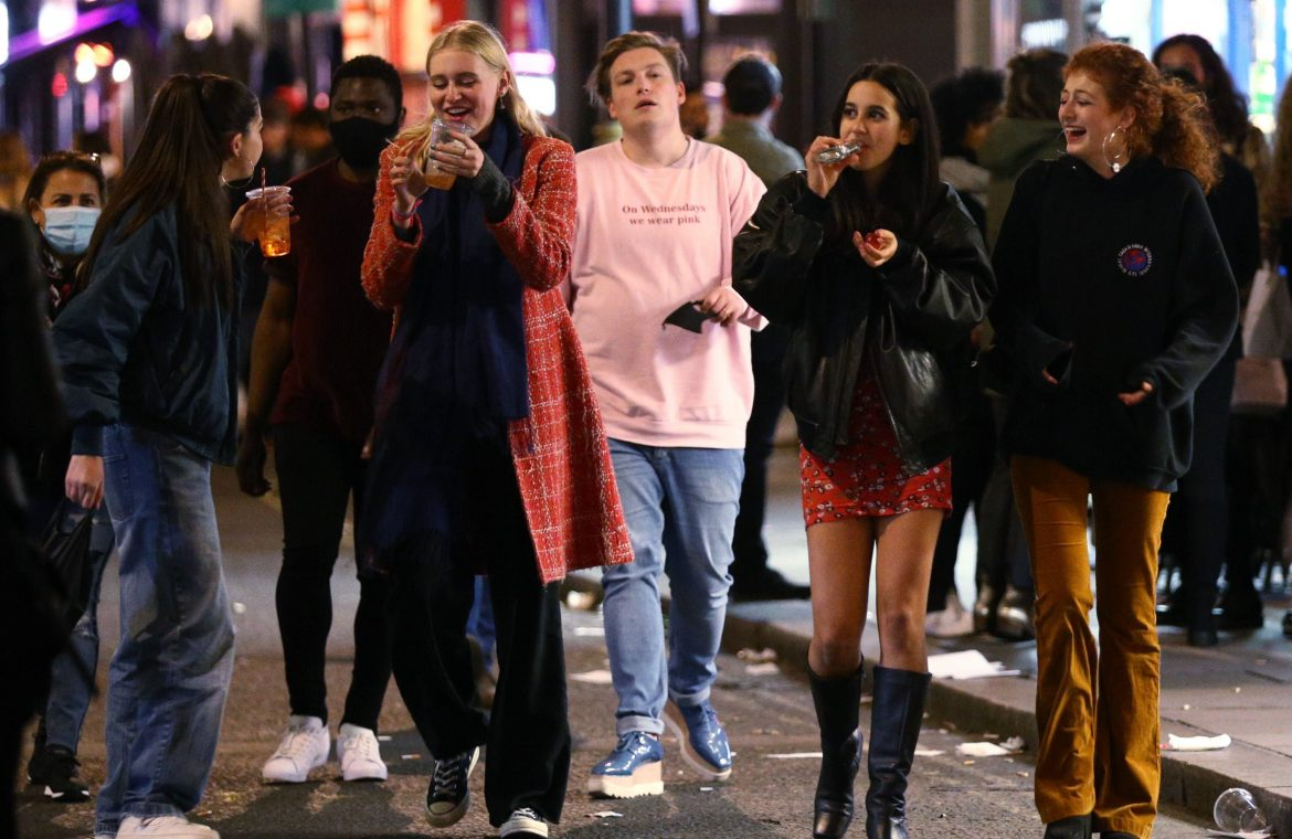 Revellers following the 10pm curfew in London