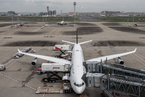 Loading a plane before departure from Haneda airport last week.