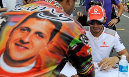 Lewis Hamilton signs during a signing session with fans at Buddha Arena in the suburbs of New Delhi in October 2012.