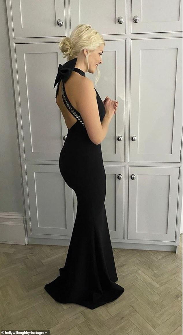 Sexy: The This Morning host, 39, looked sexy in a fancy color-coded maxi black dress by women's luxury brand Safiyaa