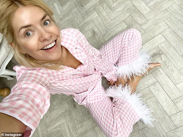 The Closing Look: Holly's sneak peak came shortly after she took to Instagram on a Sunday morning flaunting her pink pajamas as she prepares for a four-week lockdown