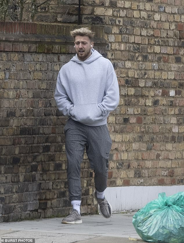 Comfort: Sam was dressed casually during a walk when he stepped out in a gray tracksuit with a light gray hoodie, while he was showcasing his hairstyle