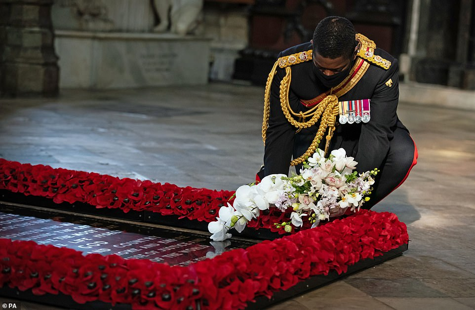 Honorable Mention: Lieutenant Colonel Nana Kofi Tomasi-Ankara laying a bouquet of flowers on the grave of the unknown warrior during a ceremony at Westminster Abbey