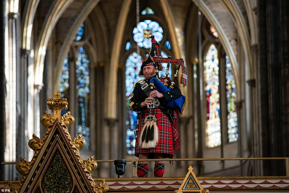 Queen Piper plays at a party in Westminster Abbey, London, last week